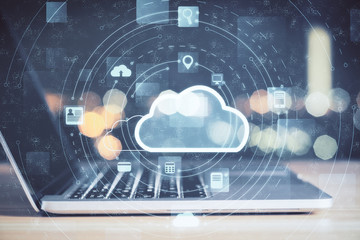 Laptop with cloud computing diagram