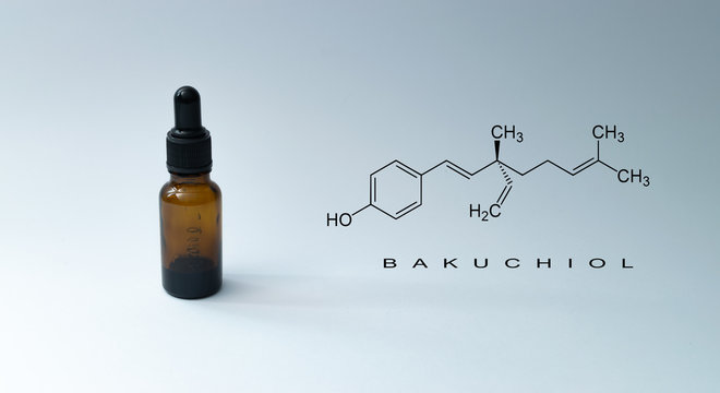 "Bottle with pipette and chemical formula with text ""BAKUCHIOL"" on green background. - Bakuchiol retinol alternative concept."