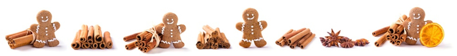 Christmas border with isolated food objects  -  Homemade gingerbread man, cinnamon sticks, orange slice, star anise  -  Objects isolated on white background