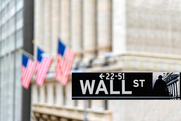 Wall street sign in New York city financial economy and business district with America national flag background. Stock market trade and exchange zone. Fotomurales