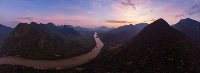 Photo sur Plexiglas Marron chocolat Aerial unique view from drone: Nam Ou river valley at Muang Ngoi Laos, sunset colorful sky, dramatic mountain landscape, travel destination in South East Asia