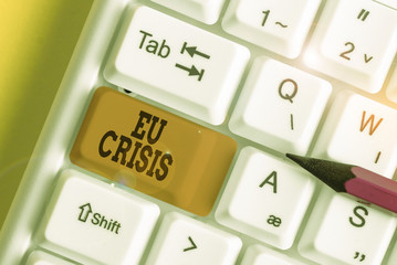 Word writing text Eu Crisis. Business photo showcasing eurozone state unable to repay or refinance their government debt White pc keyboard with empty note paper above white background key copy space