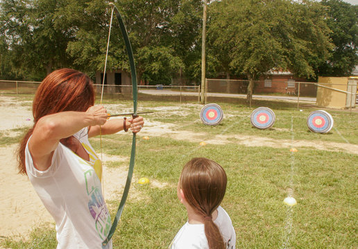 Mother and daughter doing archery