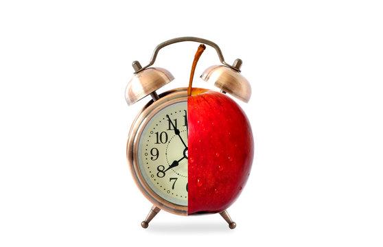 Antique clock needles Fruit healthy. Healthy food concept.