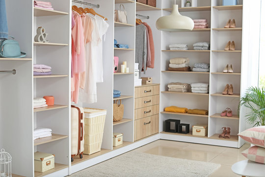 Wardrobe with stacks of clean clothes