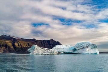 Glacier with the mountain range under the blue sky-- Jokulsarlon, Iceland