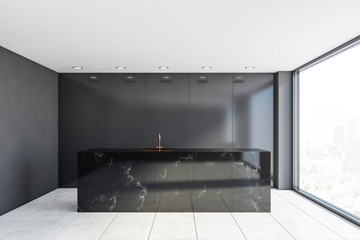 Black kitchen interior with marble countertop