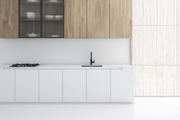 Fototapeta White kitchen interior with wooden cupboards obraz
