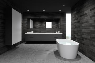 Comfortable dark tile bathroom with wardrobe