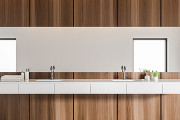 Close up of double sink in modern bathroom