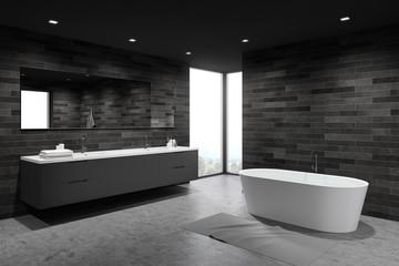 Dark tile spacious bathroom corner, tub and sink