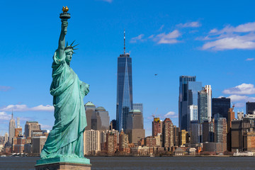 The Statue of Liberty over the Scene of New york cityscape river side which location is lower...