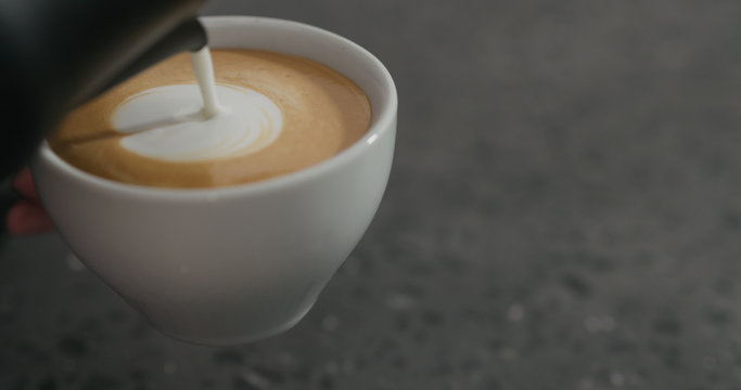 steamed milk pour into cappuccino