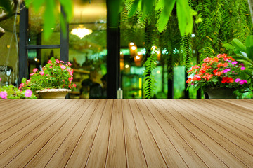 Wood floor for space use area have background plant in garden and flowe