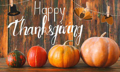 Happy thanksgiving greeting card with traditional pumpkins