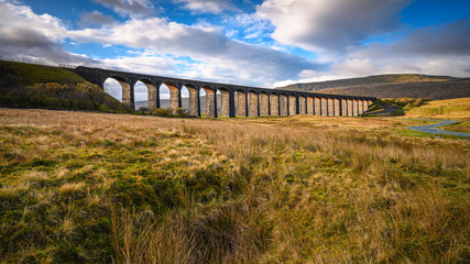 Railway Viaduct at Ribblehead, which carries the Settle to Carlisle Railway across Batty Moss spanning 400 m and 32 m above the valley floor