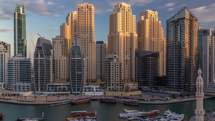Deurstickers Australië Luxury yachts parked on the pier in Dubai Marina bay with city aerial view timelapse