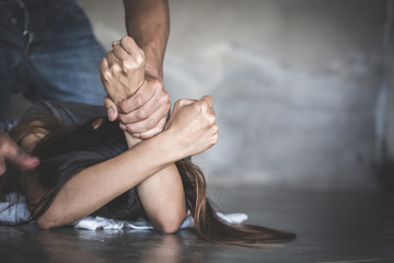 male hand holding a woman hand for rape and sexual abuse. Image for rape and sexual abuse concept. Sexual abuse is a problem or Social issues concept. Domestic violence.