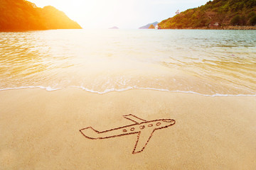 Travel vacation holiday concept. Drawing of jet plane on sand on the sea beach. Paradise tropical island background.