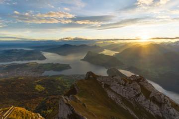 Tuinposter Bergen Beautiful sunrise panoramic view on Swiss Alps around Lake Lucerne as seen from top of Pilatus Kulm peak
