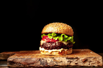 grilled burger on a stone background