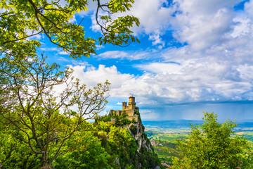 San Marino, medieval tower on a rocky cliff and panoramic view of Romagna Wall mural