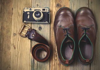 sturdy boots, leather belt, and rangefinder camera