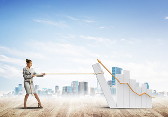 Businesswoman pulling graph with rope as concept of power and control