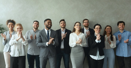 Group of business people clapping hands to congratulate boss