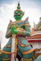 Wall Mural - Giant stand statue in Wat Arun templeof dawn