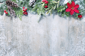 Wall Mural - Christmas and New Year background with fir branches and snowfall on wooden white board