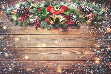 Wall Mural - Christmas background with bells, fir tree and decoration on dark wooden