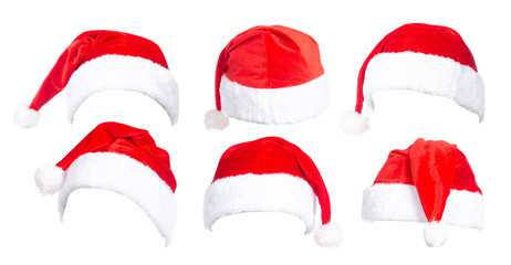 Set of red Santa Claus hats on white background isolation