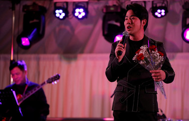 Vietnamese singer Gia Huy performs at a fundraising event organised by Britain's Vietnamese community to raise money for the families of the 39 people found inside a container, at a conference venue near Wolverhampton, Britain