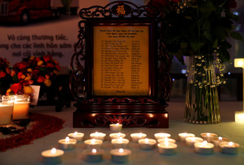 Candles are seen at a make shift memorial at a fundraising event organised by Britain's Vietnamese community to raise money for the families of the 39 people found inside a container, at a conference venue near Wolverhampton, Britain
