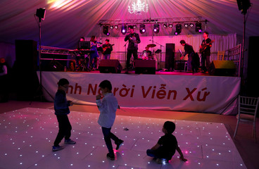 Children are seen on the dance floor at a fundraising event organised by Britain's Vietnamese community to raise money for the families of the 39 people found inside a container, at a conference venue near Wolverhampton, Britain