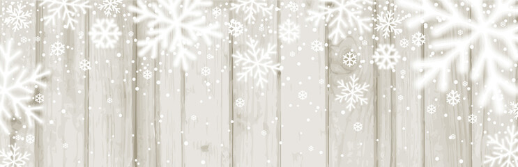 Wall Mural - Christmas banner with white blurred snowflakes on wooden background. Merry Christmas and Happy New Year greeting banner. Horizontal new year background, headers, posters, cards, website. Vector