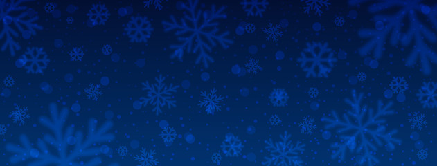 Wall Mural - Blue christmas banner with blurred snowflakes. Merry Christmas and Happy New Year greeting banner. Horizontal new year background, headers, posters, cards, website. Vector illustration