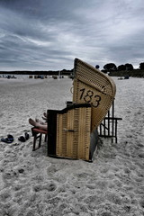 Sleeping people in their  beach chair in the evening before the rain. Schleswig-Holstein Germany, Europe
