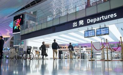 Tokyo, Japan - December 5, 2018: People walking toward departure gate at Haneda Airport International Passenger Terminal.
