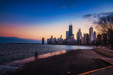 Another photographer taking a picture of the Chicago skyline at sunset.