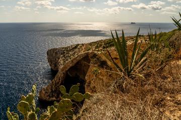 view of malta coast and mediterranean sea at blue grotto, malta