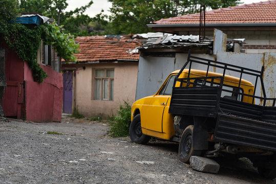 village yard with old truck in poor neighborhood