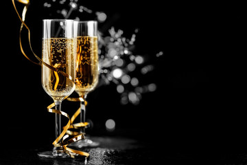 champagne glasses with sparkles