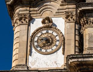 Antique clock on the Santuario de Nossa Senhora dos Remedios at the top of the baroque staircase above Lamego