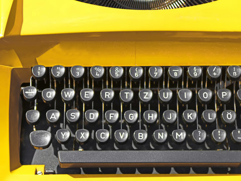 Old vintage yellow typewriter in Slovak. Close up