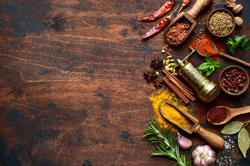 Assortment of spices and herbs. Top view with copy space.