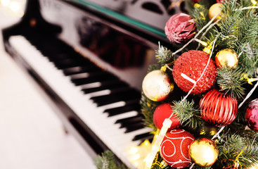 piano keys close up on Christmas decor background. The Concept Of Christmas.