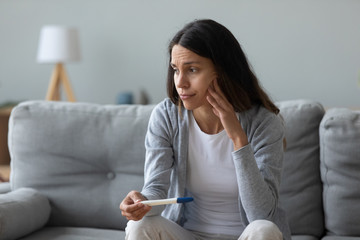 Woman feels frustrated about positive test and unplanned pregnancy