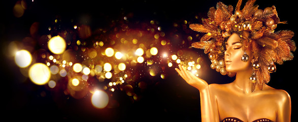 Christmas Wish. Winter Woman with Magic in Her Hand. Beautiful New Year and Christmas Tree Holiday...